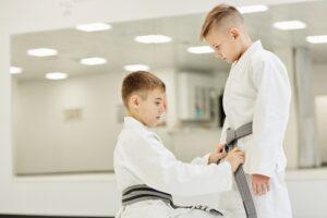 Boys tieing the belt on kimono