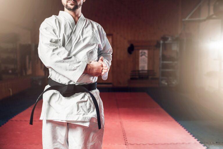 Martial arts, fighter in white kimono, black belt